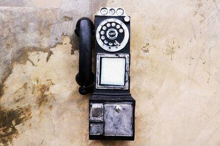 toy telephone . Old telephone on background.