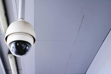 CCTV security camera operating in home. Image of CCTV security camera on background. cctv ball on safe ground.