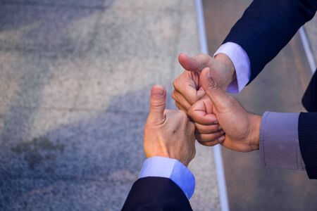Business teamwork.They are join hands  mean teamwork  and spirit.together, develop,connection.Photo concept My partner Business and Success. 免版税图像