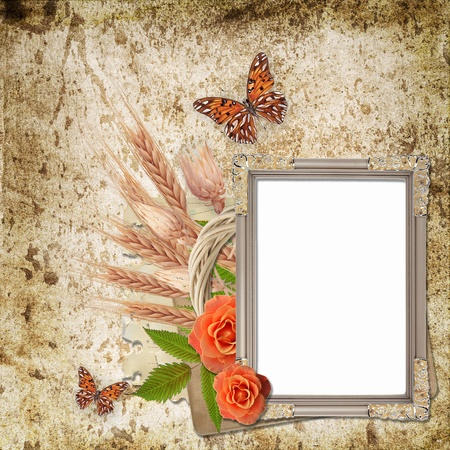 Vintage frame on grunge background with  flowers  and butterfly photo