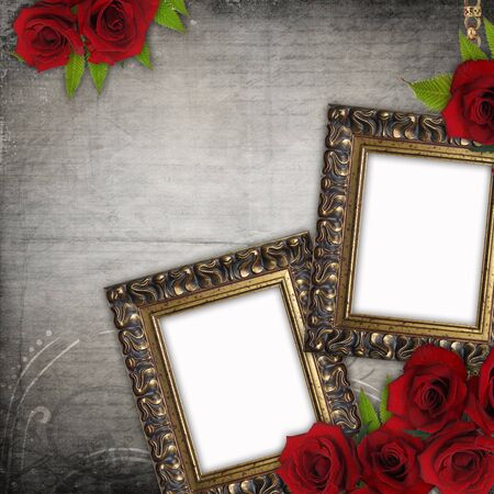 Bronzed vintage frames on old grunge background  with red roses and lace  Stock Photo