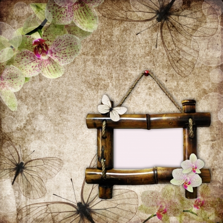 vintage background with  bamboo frame, orchids and butterfly  photo