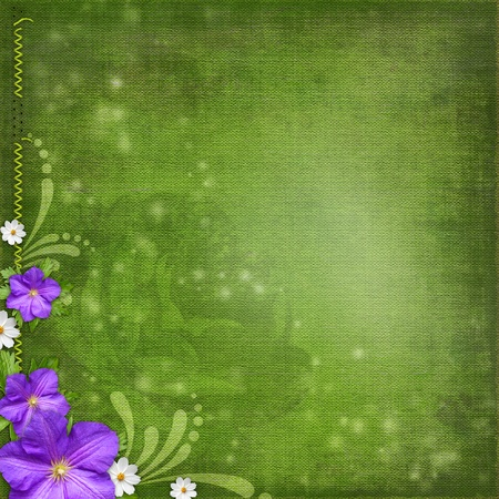 green shabby background with violet and white flowers photo