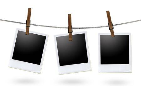 ropa colgada: marcos de fotos en blanco sobre un tendedero