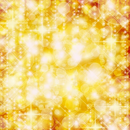 radiant: Background of defocussed golden lights with sparkles Stock Photo