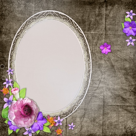 Vintage textured background with a frame for the photo or text and with flowers  Stock Photo