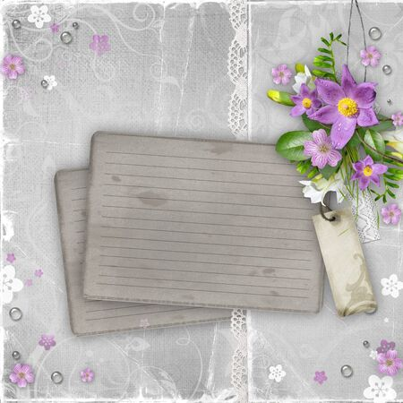 vintage paper card with spring flowers on textured background photo