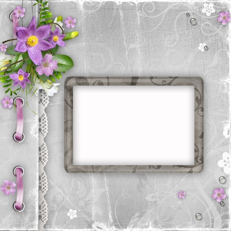 vintage paper photo frame with spring flowers on textured background photo