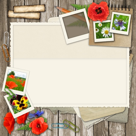 collage  with photo frame, flower, old paper on wood background  photo