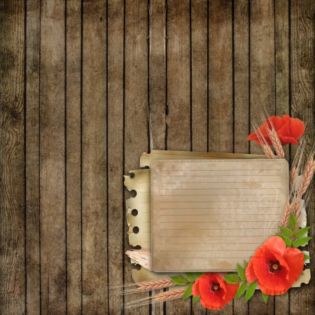 wooden background with paper card and poppy  photo