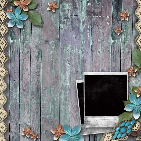 empty frame: Old wooden background with a frame for photo, flowers, pearls and lace