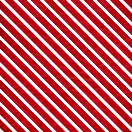 red soil: A crumpled  paper in a red and white stripe pattern for use as a background