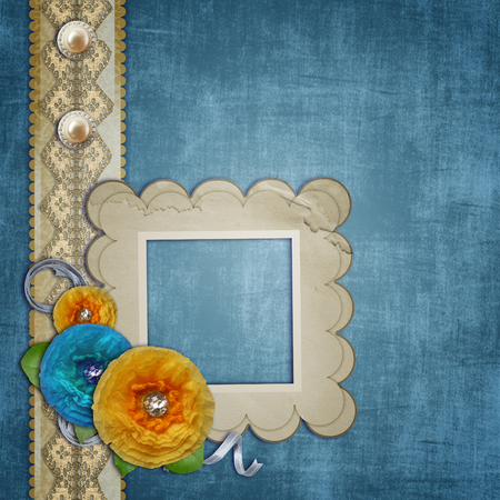 Blue vintage textured with a bouquet of paper flowers, lace and pearls  photo