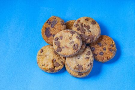 Chocolate chips cookies on a blue background