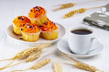 Expresso coffee with halloween muffins 스톡 콘텐츠