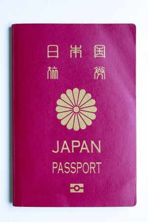 Japanese passport front cover on a white background