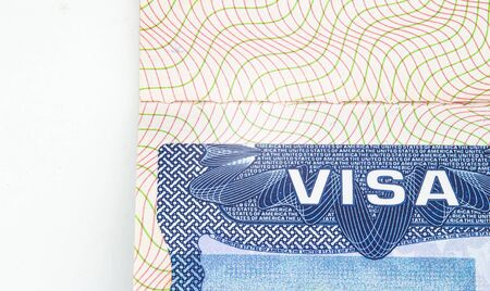 A close up top view to an USA visitor visa permit with white space on the left