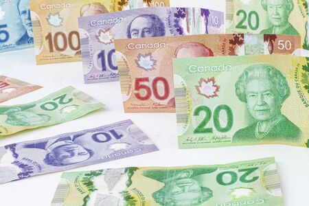 A Collage of Canadian currency bills