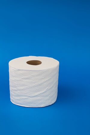 Toilet paper on a blue background with soft shadow