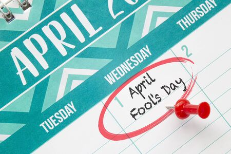 April Fool's Day on a calendar with a red pin 스톡 콘텐츠