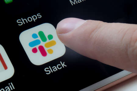 Calgary, Alberta, Canada. March 12, 2020.A person about to use Slack app which is a proprietary instant messaging platform
