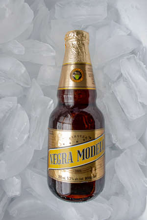 Calgary, Alberta, Canada. May 20, 2020. A Mexican beer Negra Modelo bottle on a bed of ice