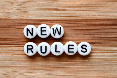 New Rules test on a brown wooden table