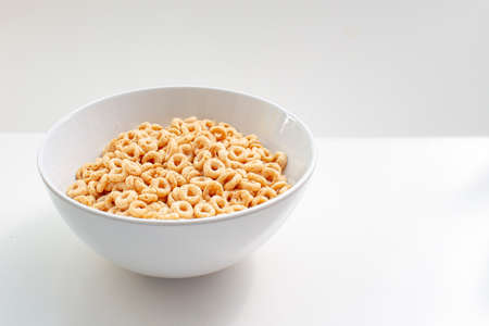 A plate of whole wheat cereal consisting of pulverized oats in the shape of a solid torus. Banco de Imagens