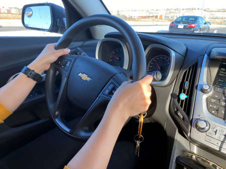 Calgary Alberta, Canada. Oct 17, 2020. A person driving a Chevrolet car on a sunny day Editorial