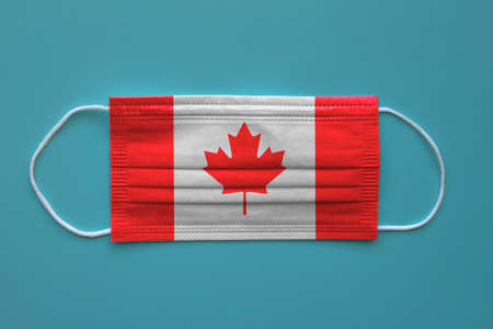 A face mask with a Canadian Flag on a clear background