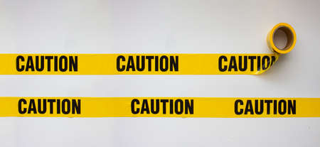 Caution safety barricade tape on white