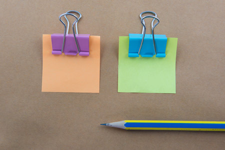 memorize: Color  Paper notes with sticky note on brown Background