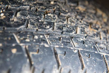 dirty car: Tire marks, old and dirty black tyres tread pattern, for car, close-up Stock Photo