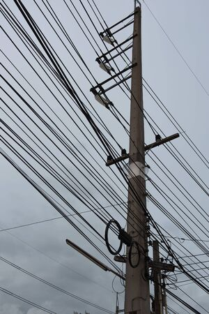 electricity post: Eletricity line and electricity post  the cable on pole Stock Photo