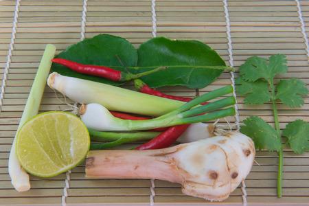 Combine soup, herbal Thai Food on the wooden floor. Tom Yum