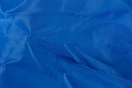 satiny: Disastrously of blue fabric texture for background.
