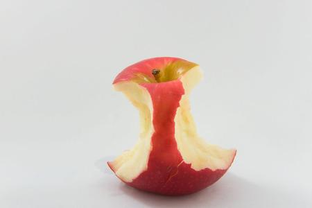 Bite Fresh Red apple fruit on White background