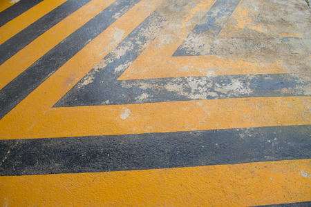 disallow: old yellow and black painted cement floor background