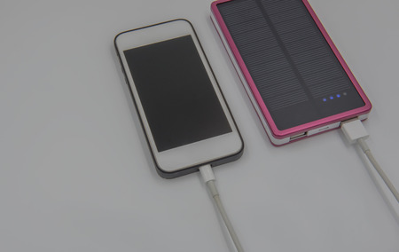 solarcell: Smartphone charging on white background