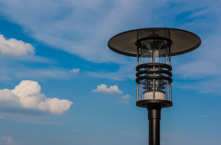 Outdoor modern lamp blue sky background .