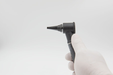 Otoscope  in hand doctor on the white background . medical equipment . Stock Photo