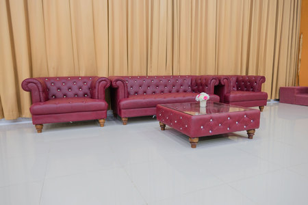 Set red sofa and Yellow curtains background .