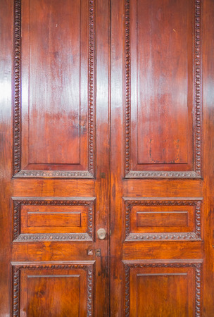 close-up of ancient pattern wooden door .