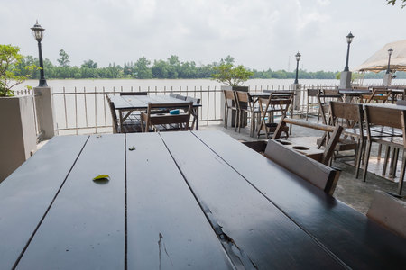 dining table and chairs: Wooden table and chair outdoor at Riverside .