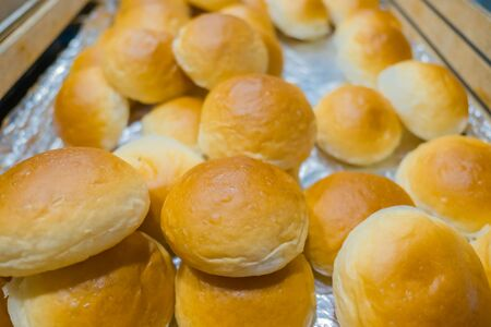 round: Many bread Roll placed  in wooden tray .