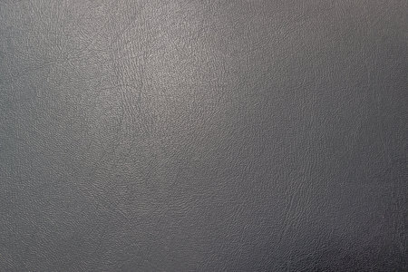 hole: closeup perforated artificial black leather background texture .