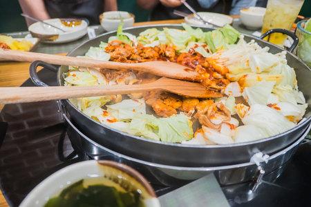Dak Galbi Korean spicy food on hot pan . Stock Photo
