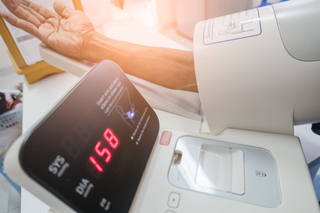 checking the blood pressure in the hospital with a digital equipment .