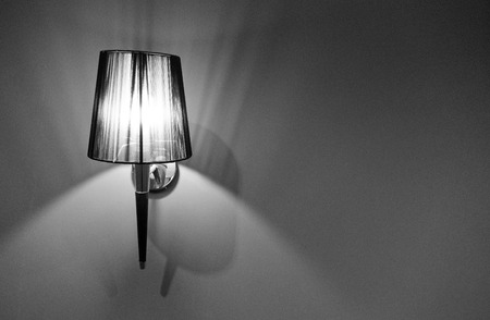 indoor lighted classic lamp on the wall , vintage lamp .
