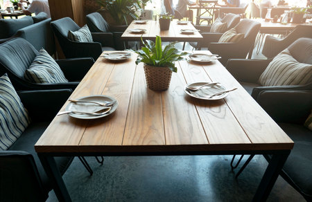 empty wooden table at restaurant and white plate on table .